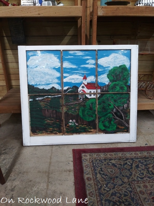 hand painted church landscape on an old window