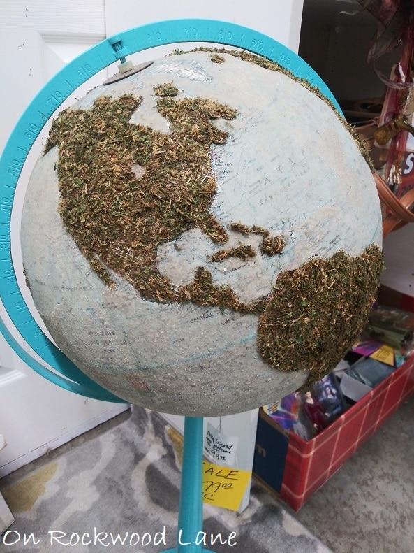 Moss covered standing globe