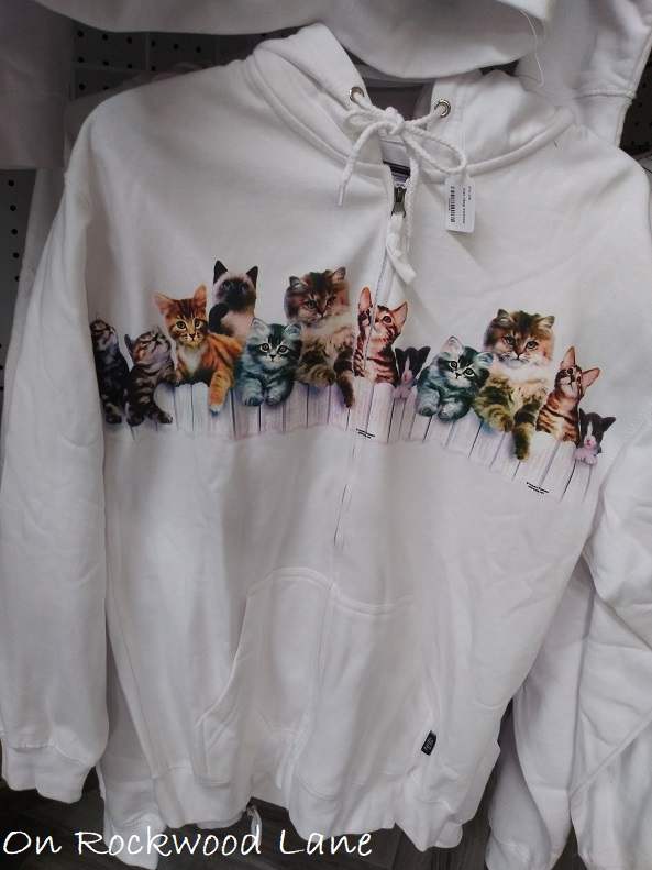white zipper hoodie with a row of cats on the front