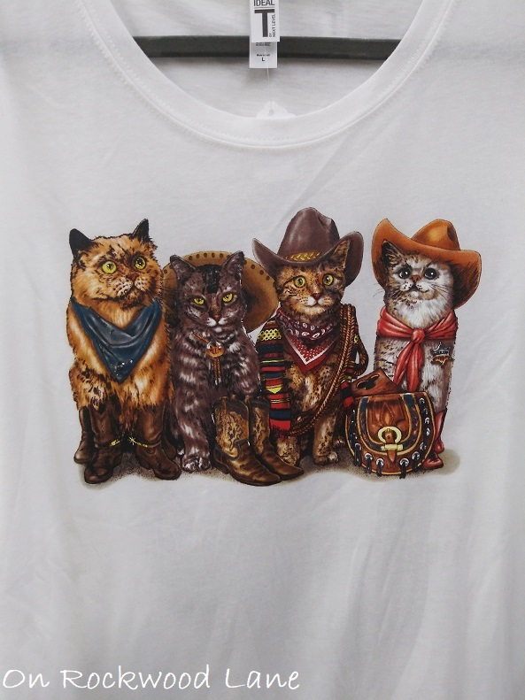 white t-shirt with cats dressed like cowboys