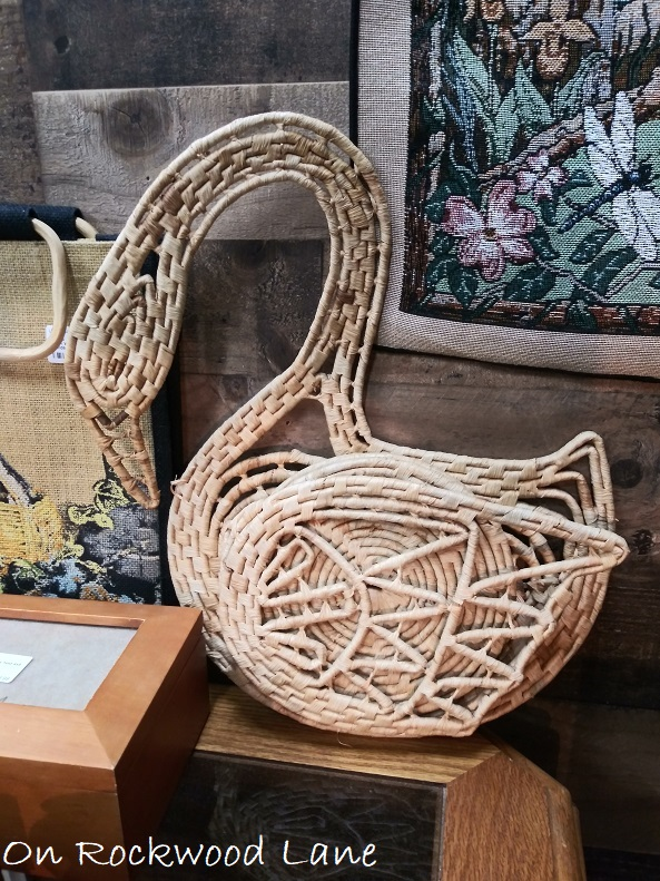 woven swan trivet set with coasters tucked in the wing