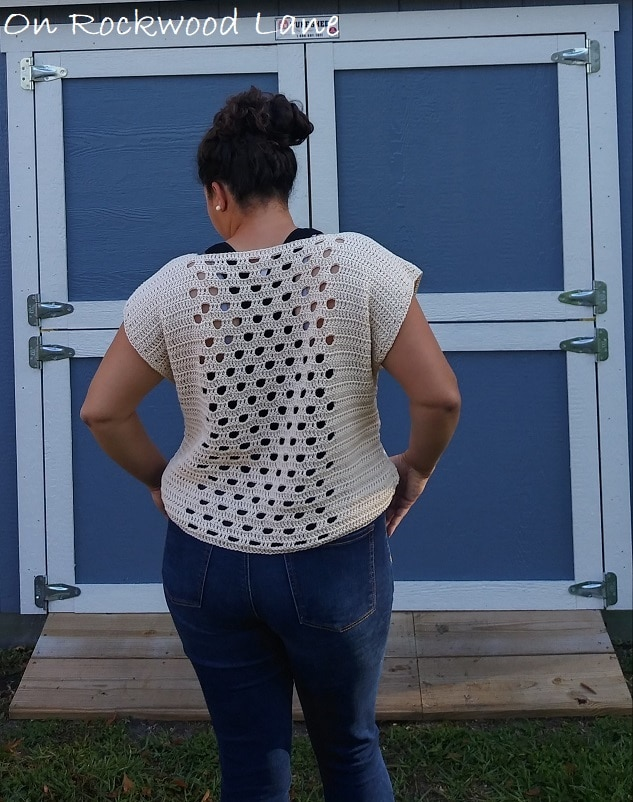 Summer outfit, Cream colored crocheted tee, black tank top, blue jeans, messy bun, cream studs, On Rockwood Lane, Spring outfit