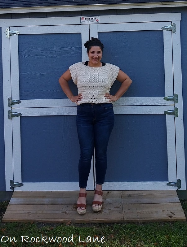 Summer outfit, Cream colored crocheted tee, black tank top, blue jeans, brown wedges, messy bun, cream studs, On Rockwood Lane, Spring outfit